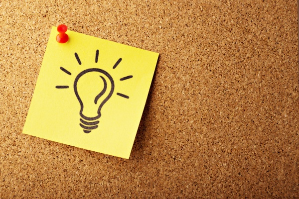 Post it note with lightbulb innovation