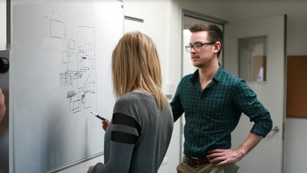 Team members at whiteboard